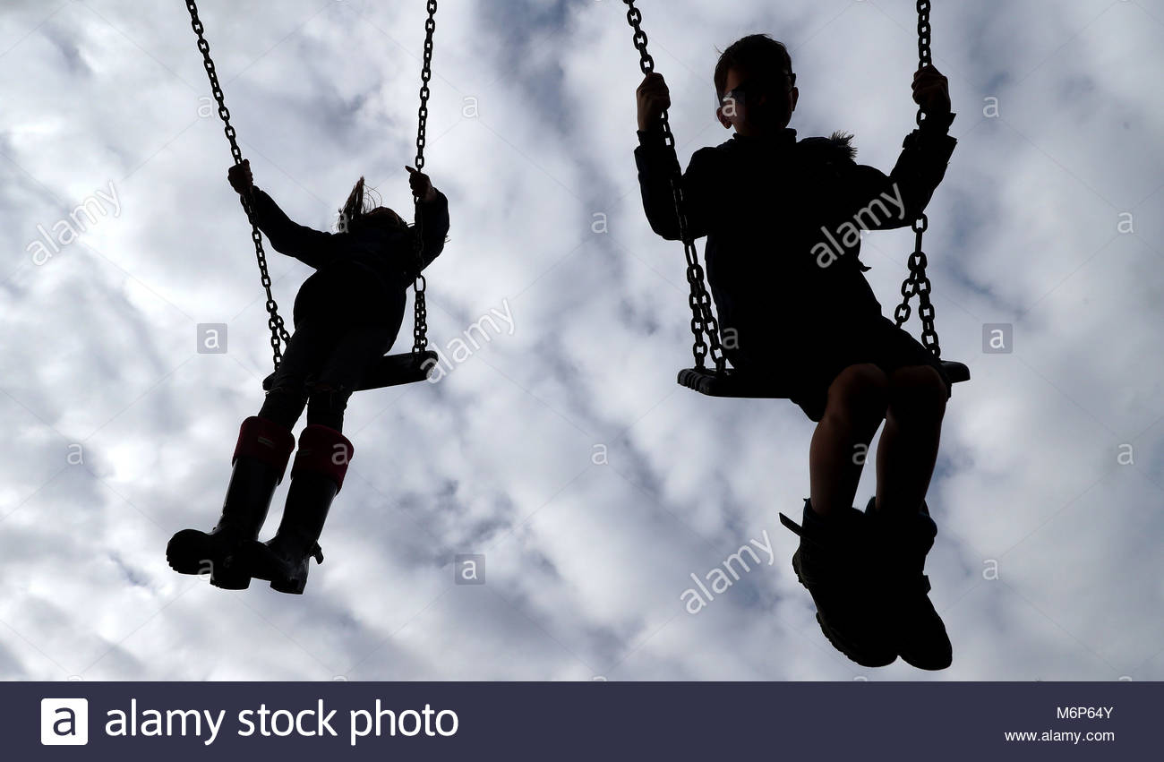 PERMISSION GRANTED. File photo dated 04/03/17 of children on swings in a park, as a senior Ofsted official Gill - Stock Image