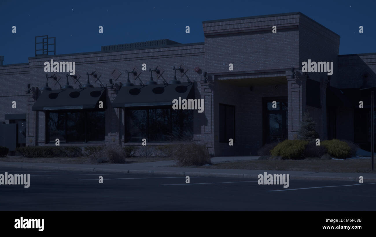 Exterior generic restaurant diner establishing photo night time. Tight shot of front entrance with no signage for - Stock Image