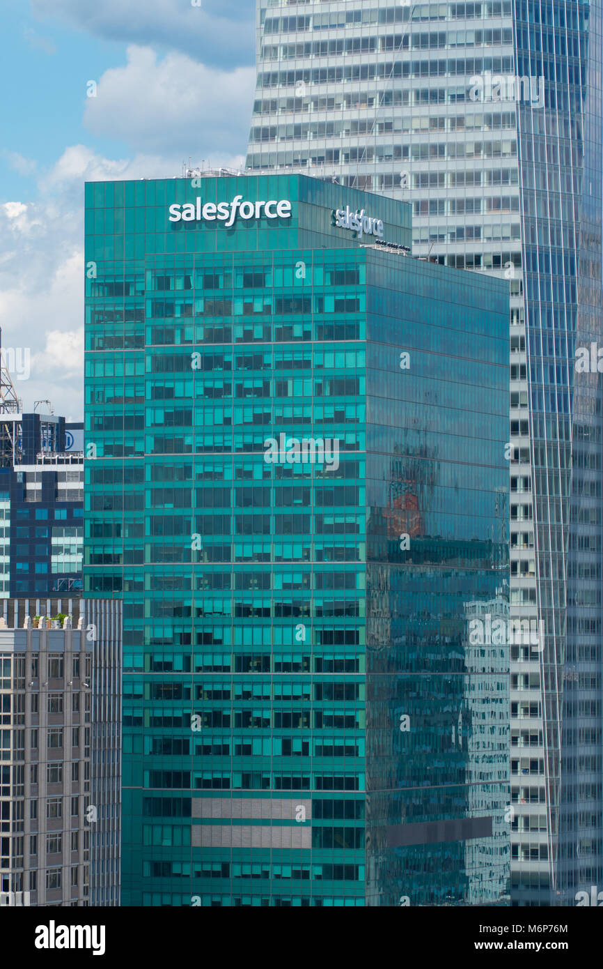 New York City, Circa 2017: Salesforce building green window facade in midtown Manhattan NYC. White sign replace - Stock Image