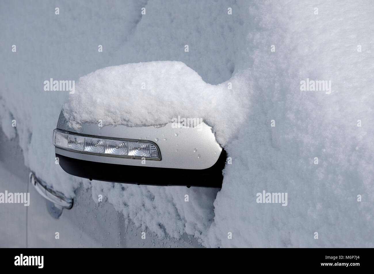 motor vehicle covered in winter snow, norfolk, england - Stock Image
