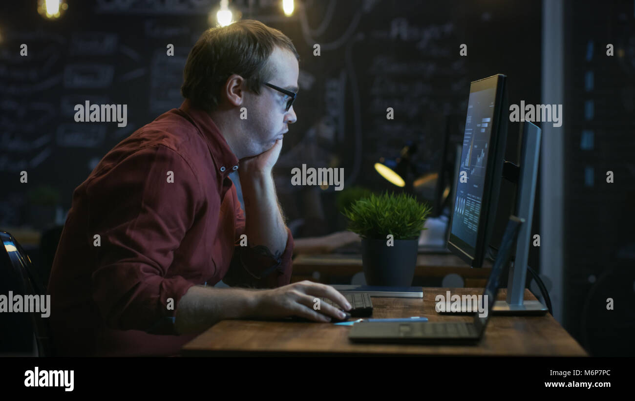 Stressed, Overworked Financier Makes Face Palm Gesture in Frustration while Working on a Personal Computer with - Stock Image