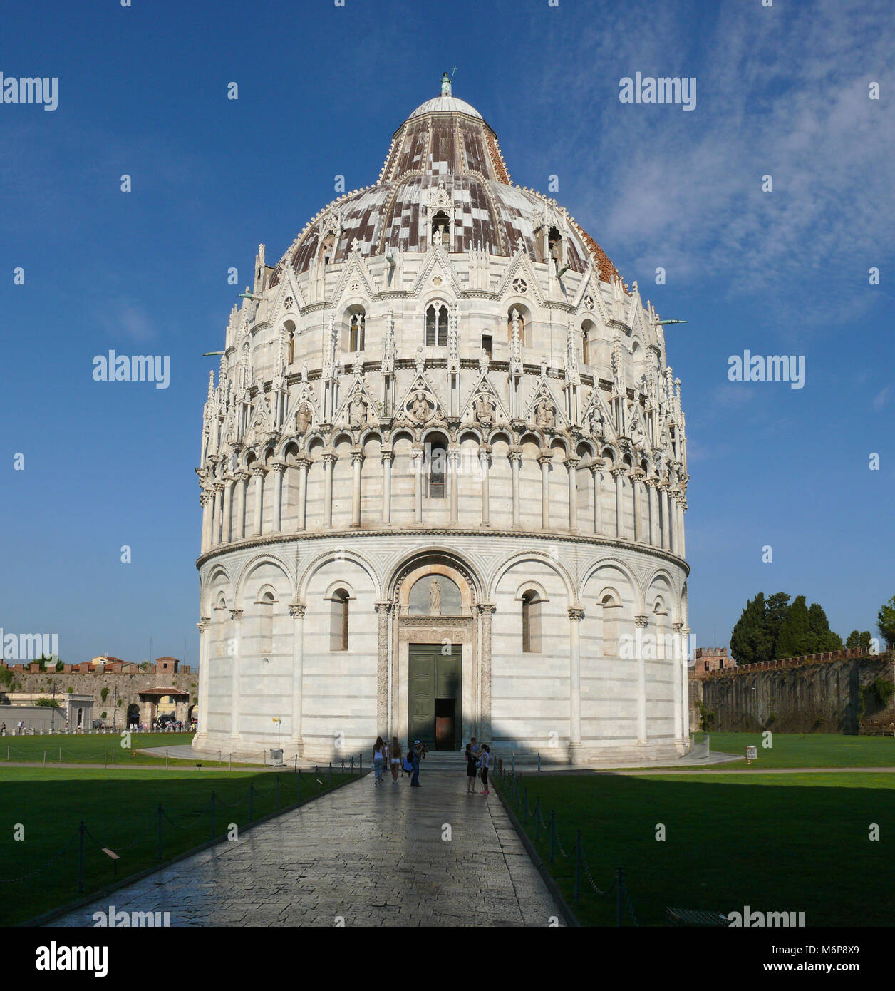 Pisa, Italy, august 2, 2014: The Pisa Baptistery on The square of Miracles in the morning Stock Photo