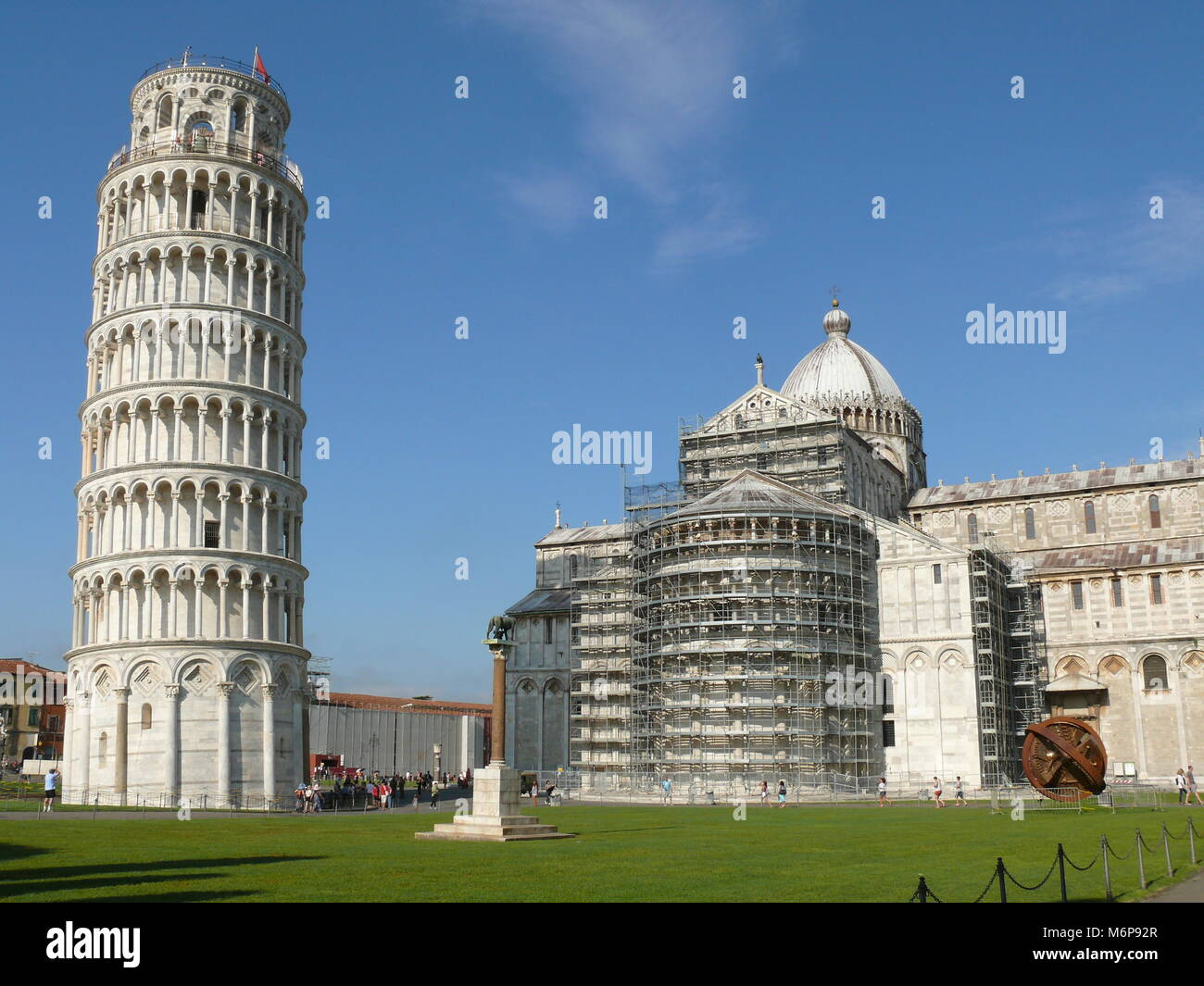 Pisa, Italy, august 2, 2014: The leaning tower and Pisa Cathedral in The square of Miracles Stock Photo