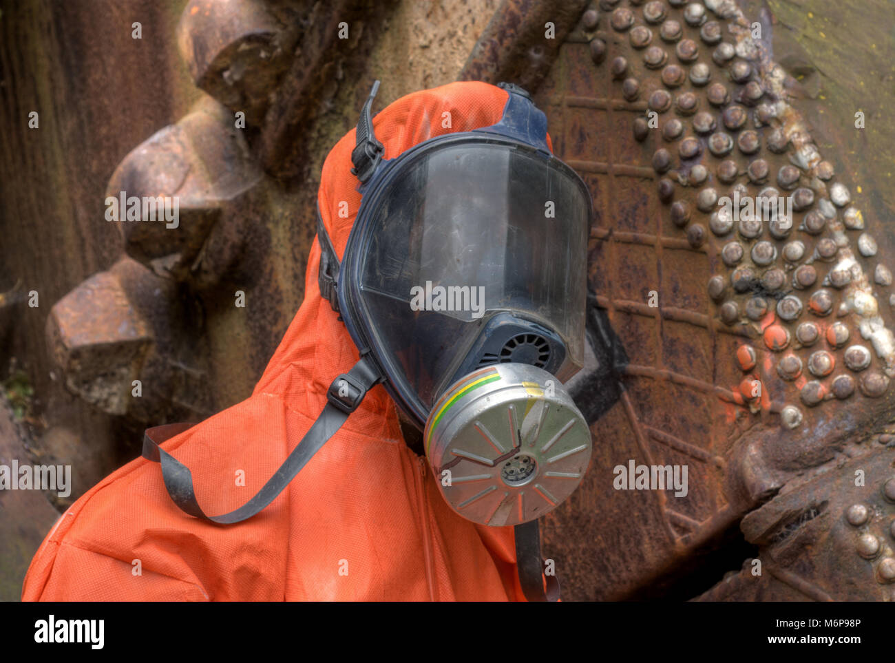 Mannequin dressed in a chemical protection suit. nuclear industry - Stock Image