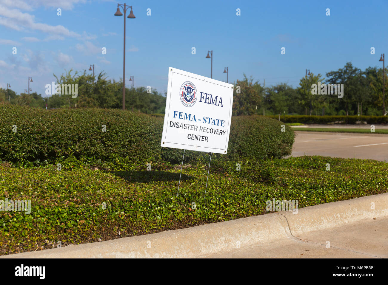 Signs posted direct residents to a FEMA Disaster Recovery Center - Stock Image