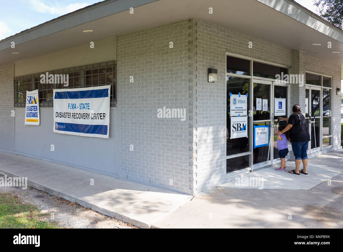 A State of Texas/FEMA Disaster Recovery Center at the Bayland Community Center (Harris County) staffed with recovery - Stock Image