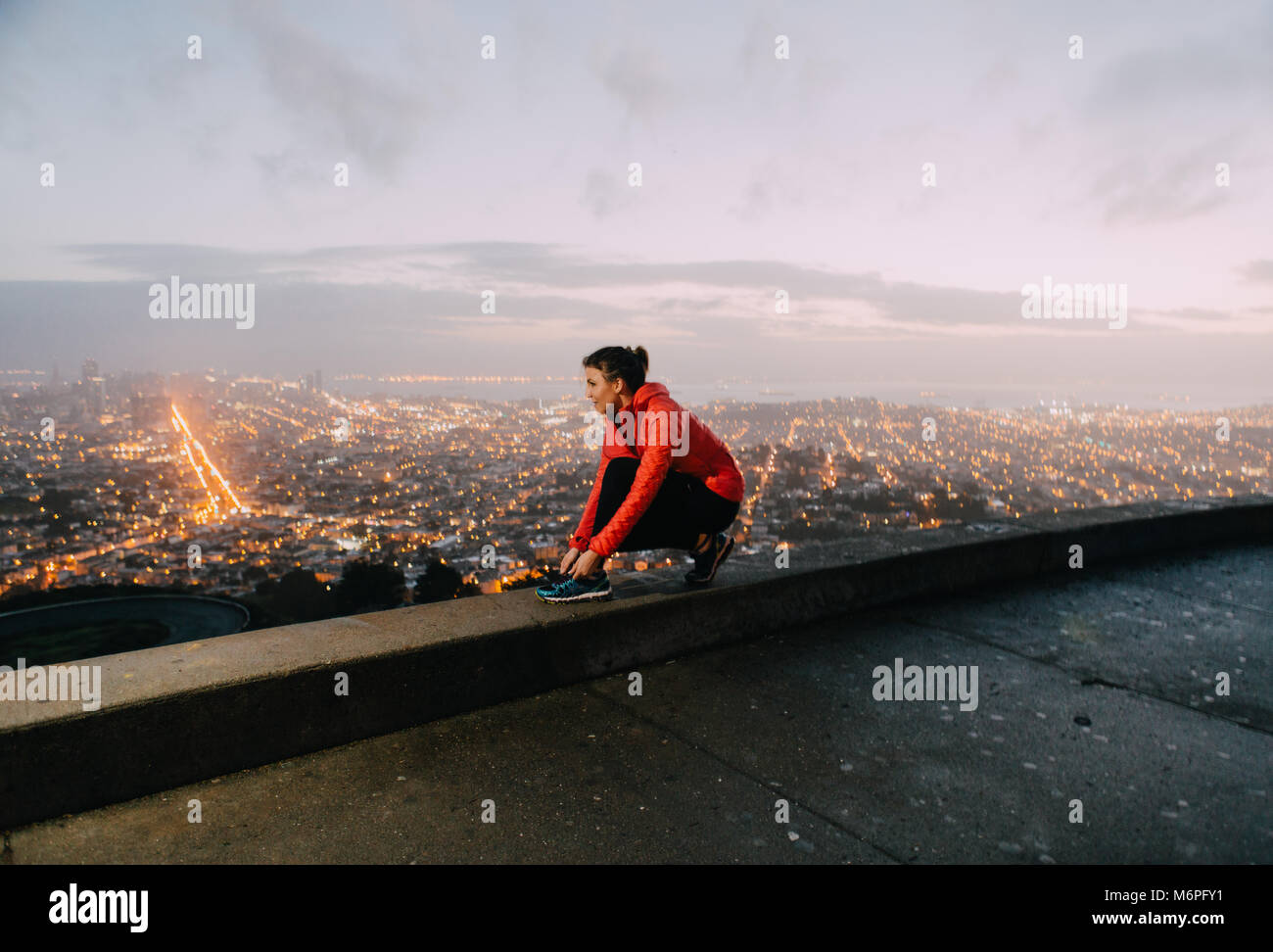 A young woman going for a morning run in San Francisco. Stock Photo