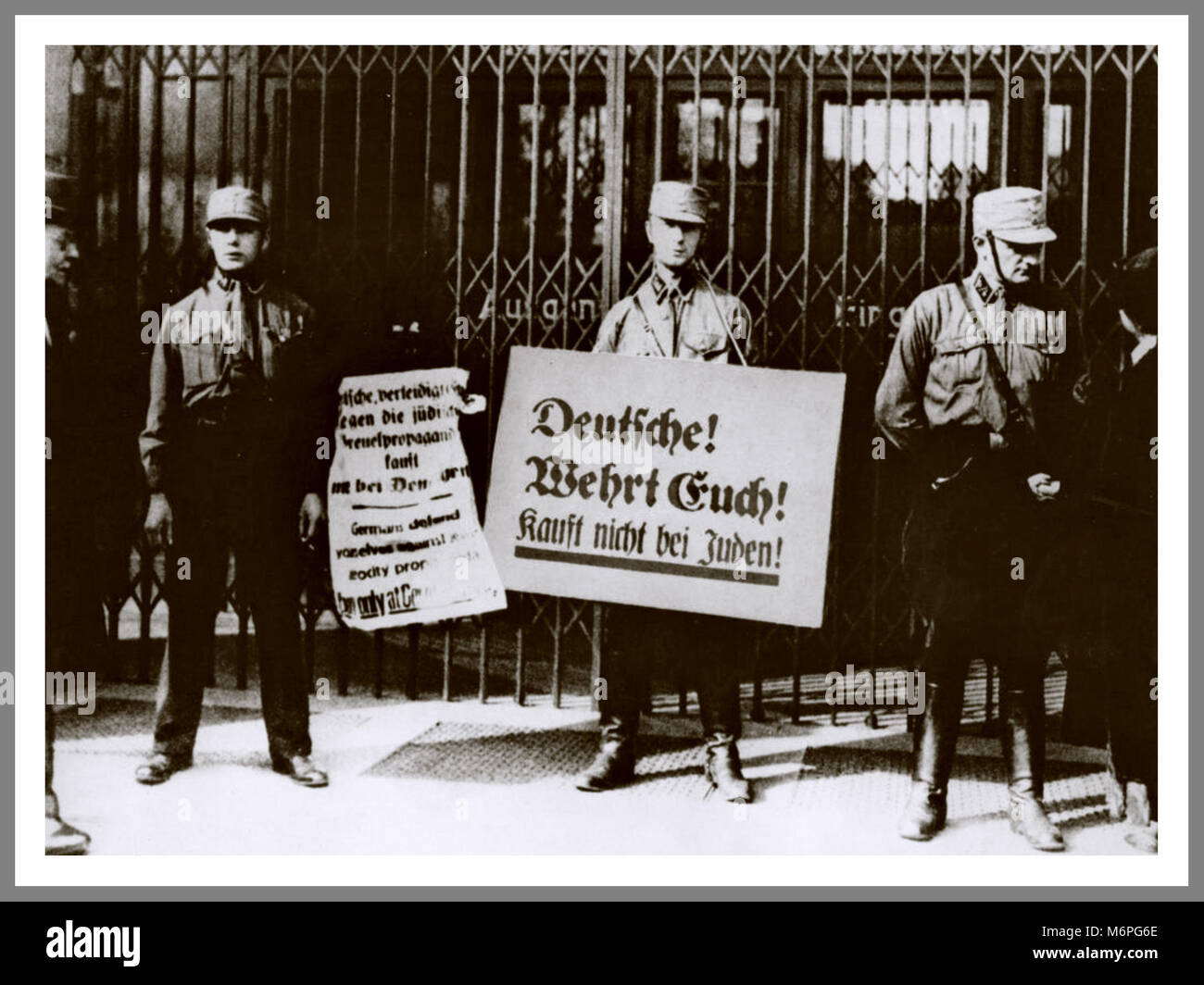 Vintage 1930's NSDAP Nazi Brownshirts holding placards saying 'Don't buy from Jews, shop in German businesses!' - Stock Image