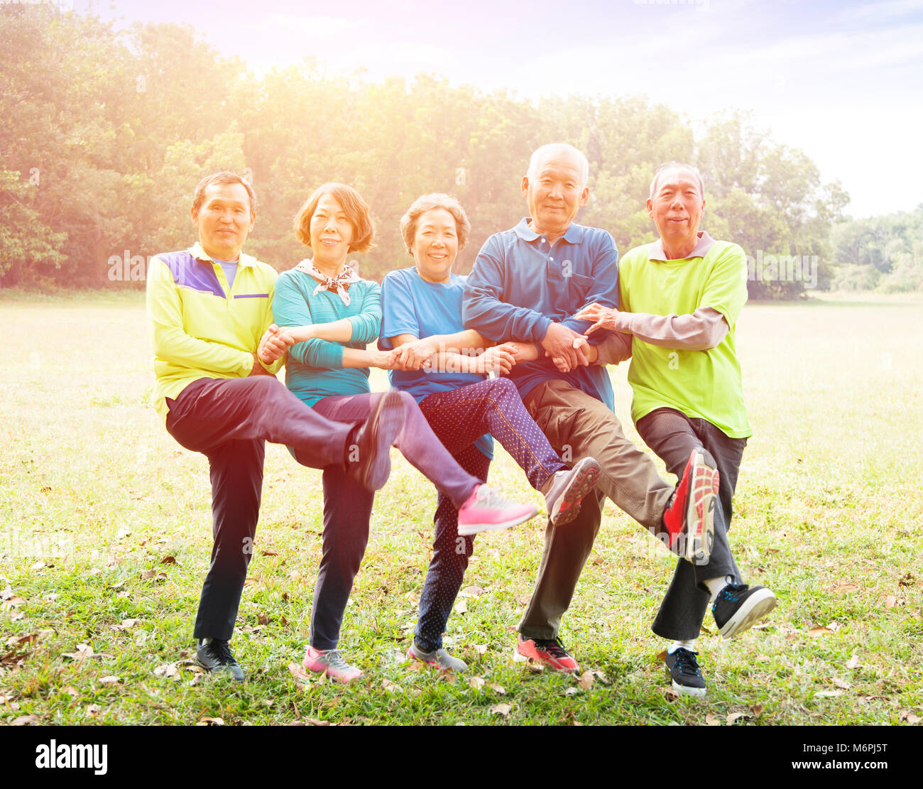 Senior Group Friends Exercise and dance in the park - Stock Image