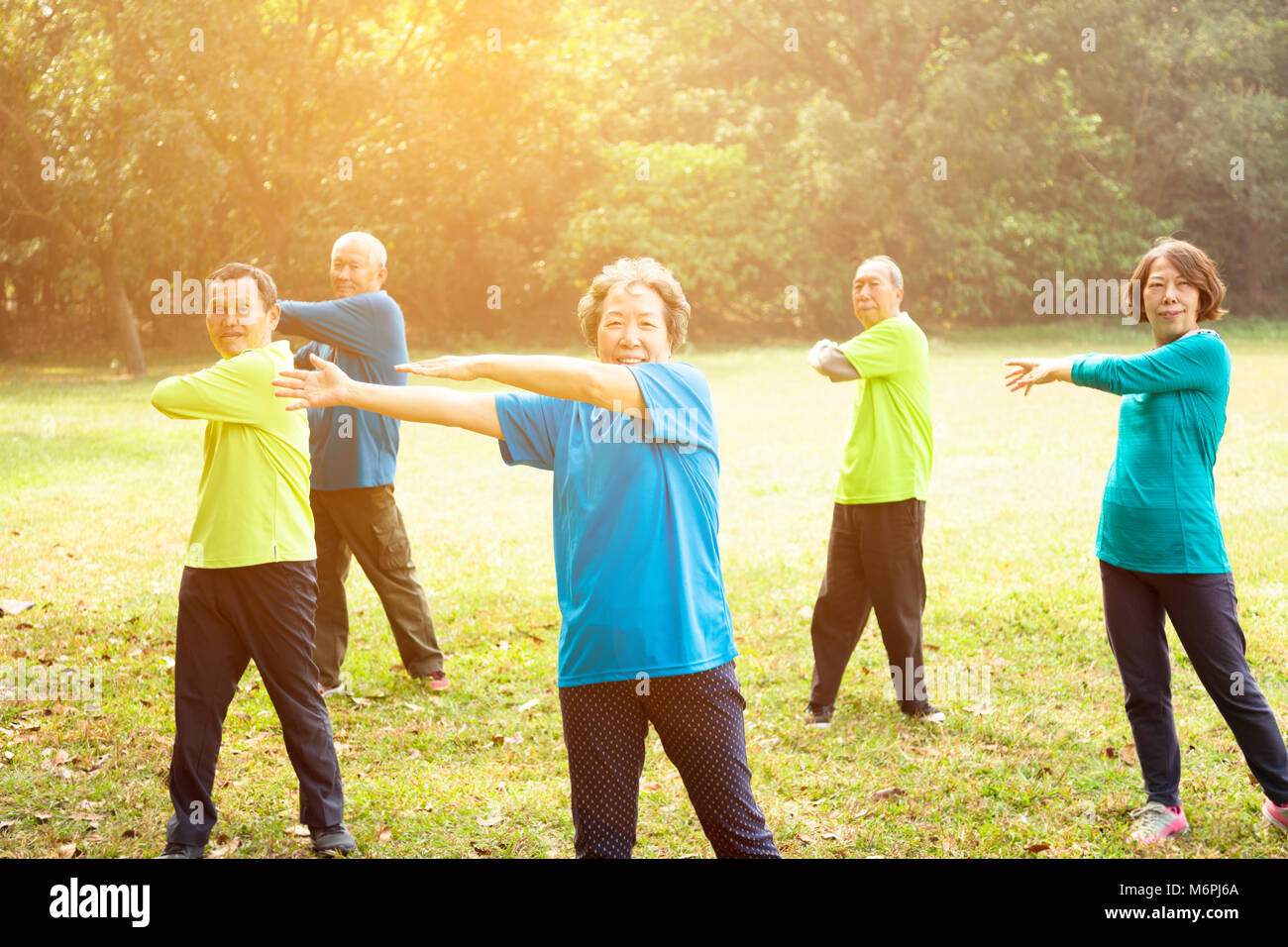 happy Senior Group Friends Exercise in the park - Stock Image