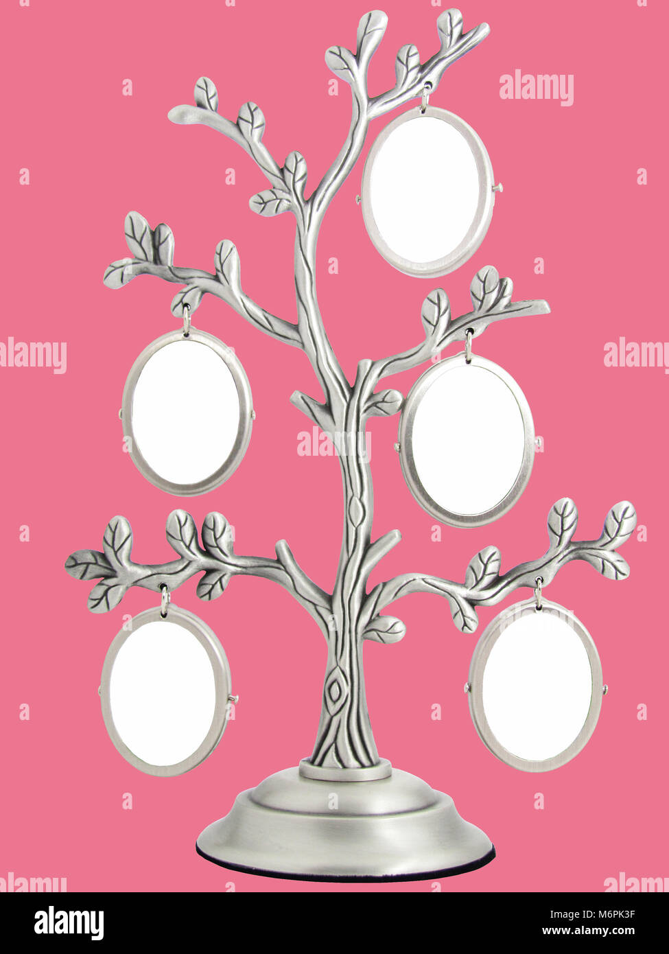 Frames for photos in a family house tree on a pink background - Stock Image