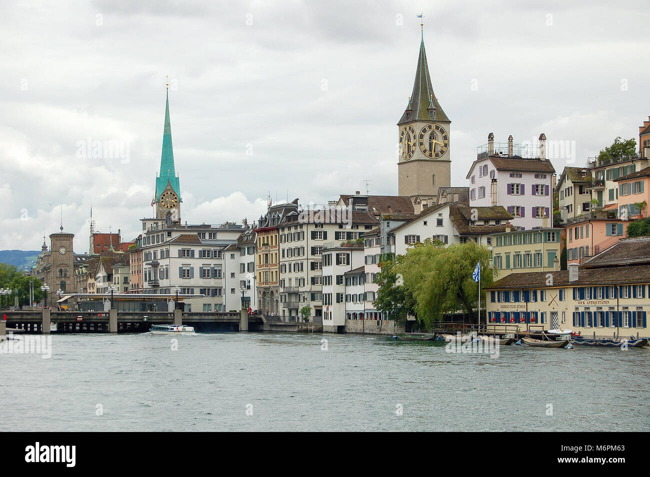 St Peter Church (Kirche) and Our Lady (Fraumunster) Church along the Limmat River - Zurich, Switzerland - Stock Image