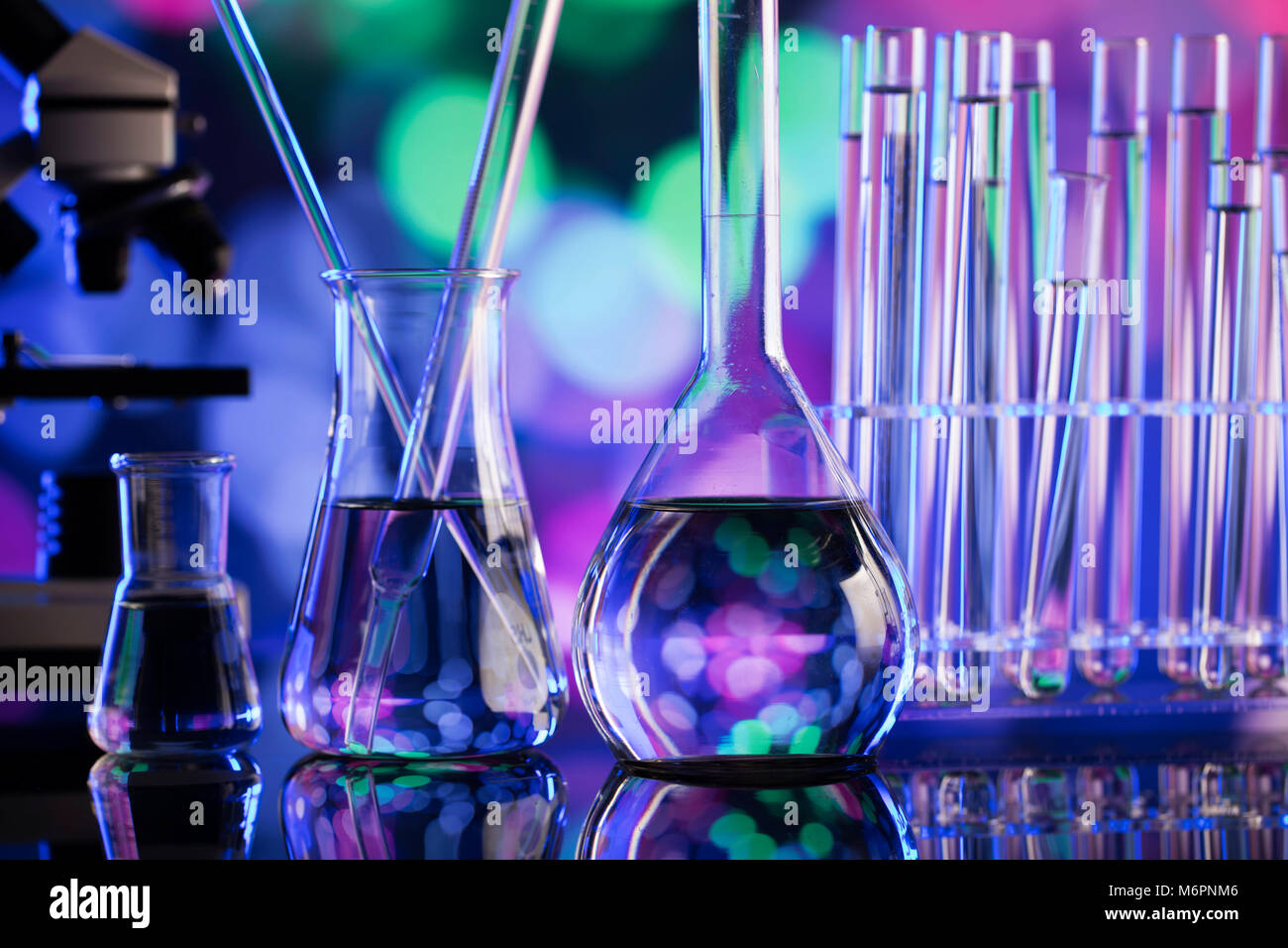 Science concept background. Microscope and laboratory glassware composition. Stock Photo