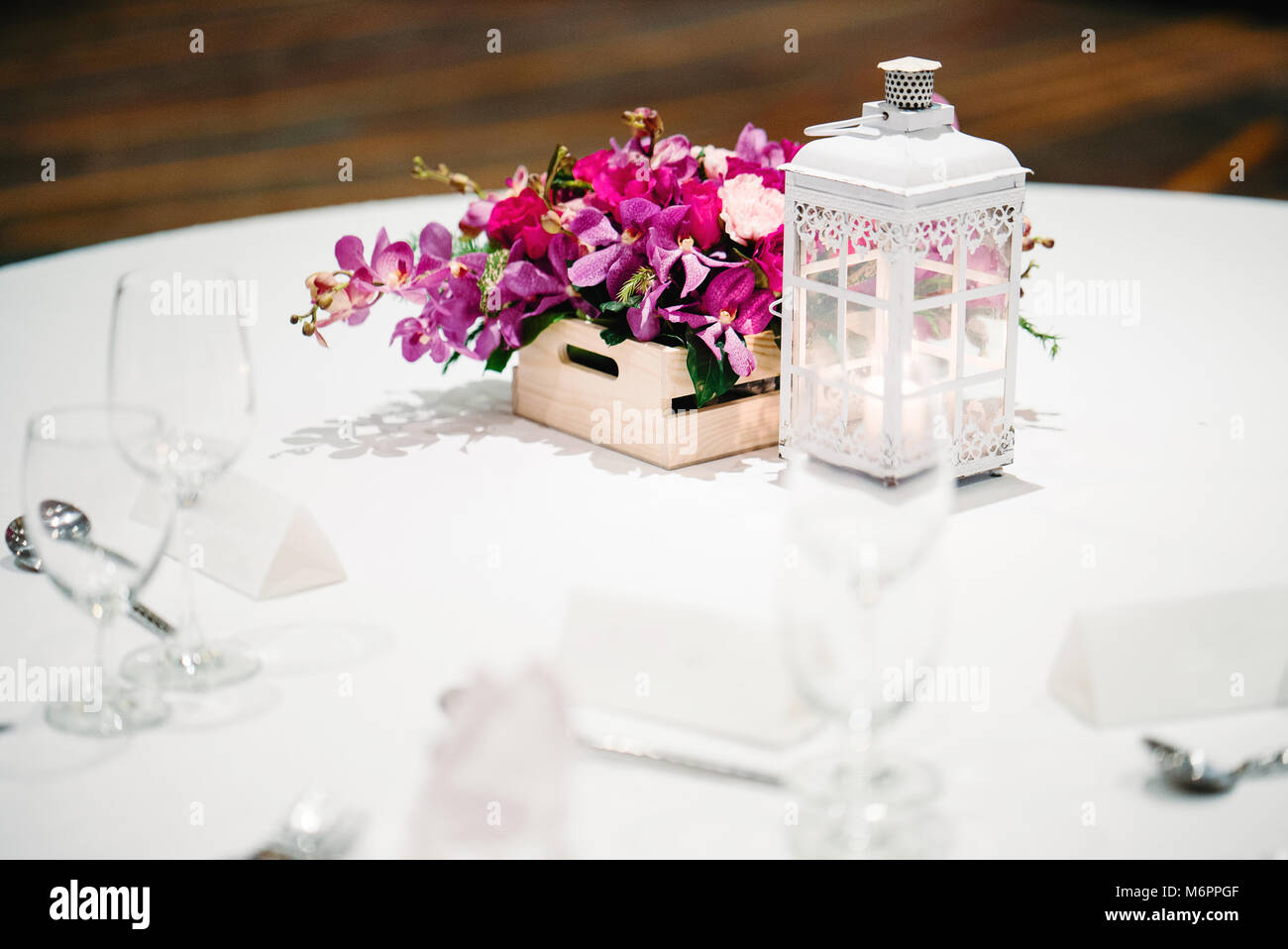 The wedding reception dinner table setup decorated with the candle ...
