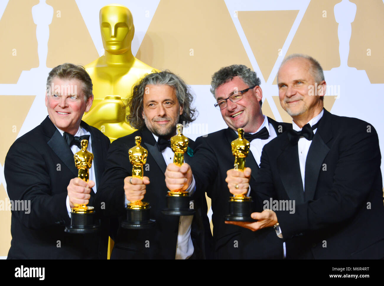 Visual effects artists Richard R. Hoover, Paul Lambert, Gerd Nefzer and John Nelson, winners of the Best Visual - Stock Image