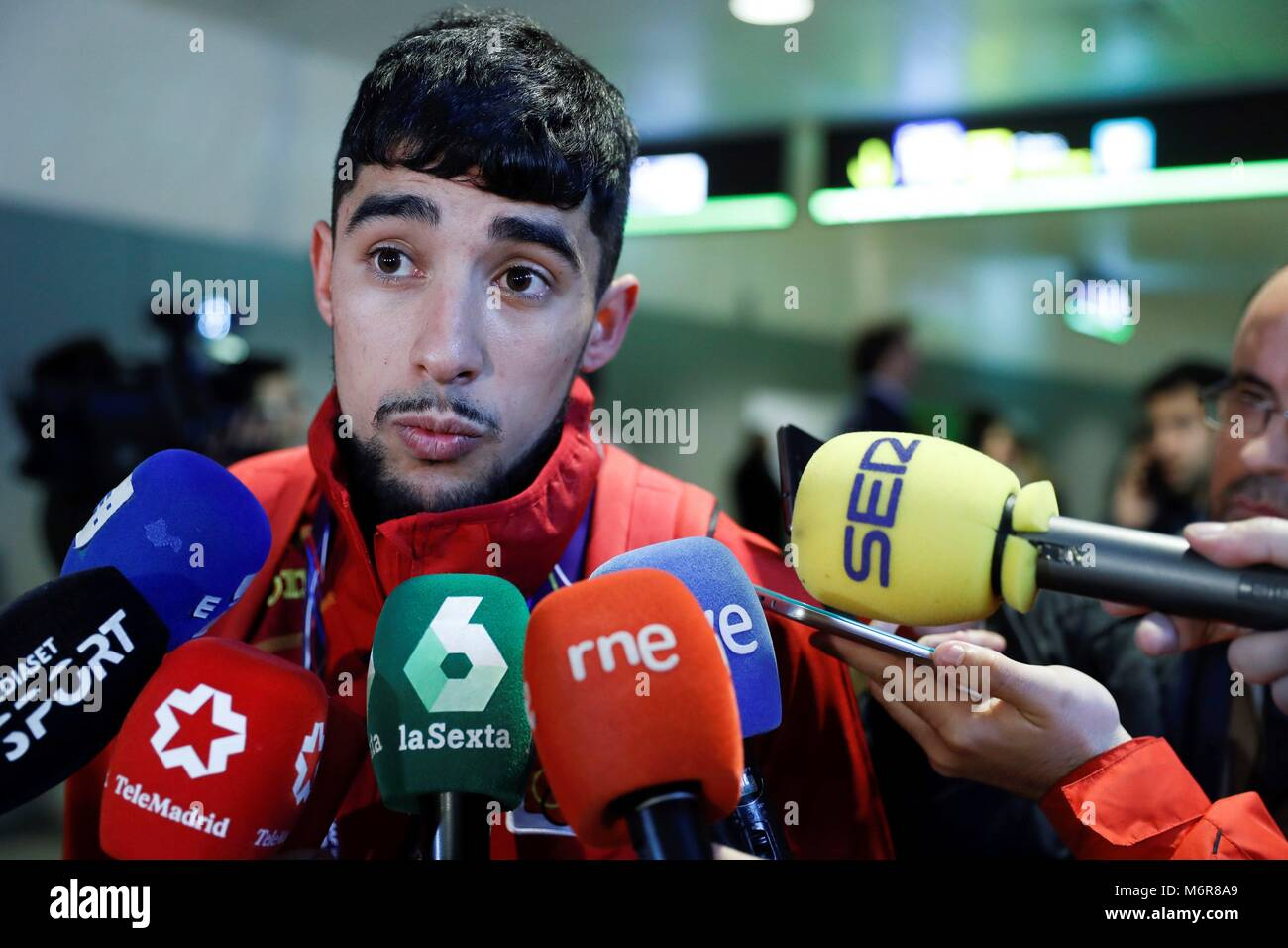 Madrid, Spain. 06th Mar, 2018. Spanish athlete Saul Ordonez (L), bronze medal in the 800 metres, addresses the media - Stock Image