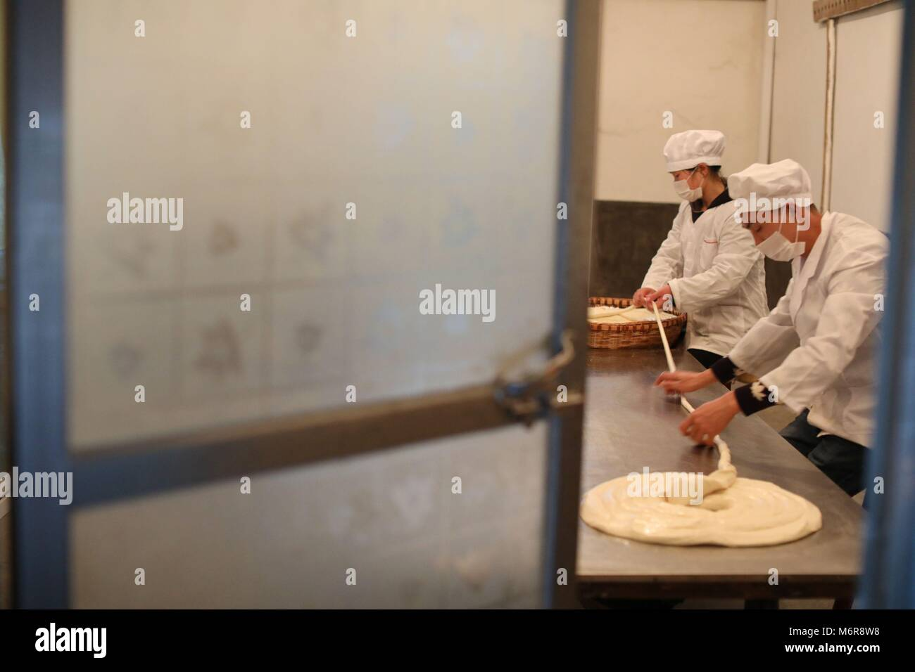 Suiyang. 6th Mar, 2018. Workers make traditional hollow noodles at a noodle-making company in Suiyang county of Stock Photo