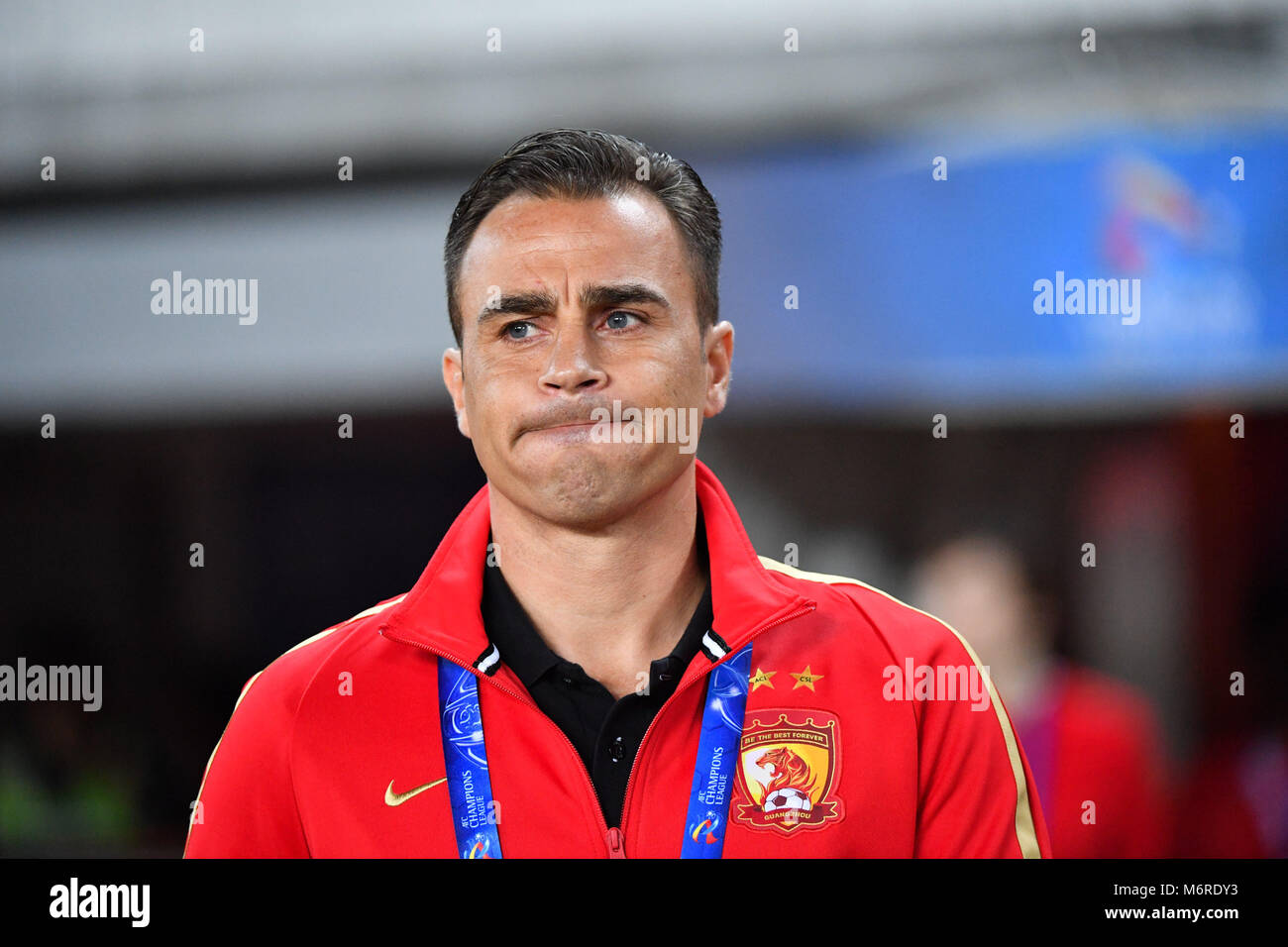 Guanghzou, China's Guangdong province. 6th Mar, 2018. Head coach of Guangzhou Evergrande Fabio Cannavaro reacts Stock Photo