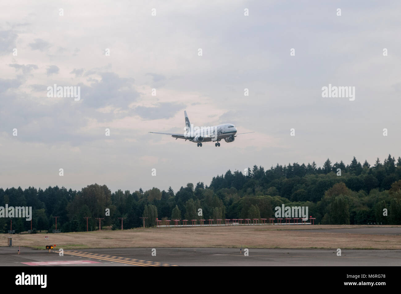 Alaska airlines stock photos alaska airlines stock images alamy seattle washington sea tac airport alaska airlines landing at the airport buycottarizona Choice Image