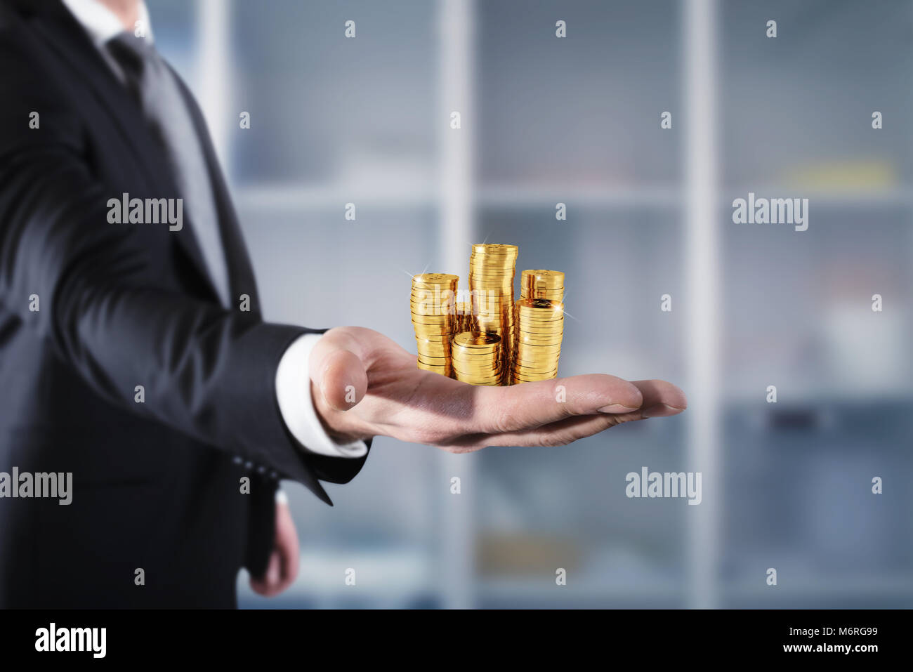 Businessman hold piles of money. Concept of success and company growth - Stock Image