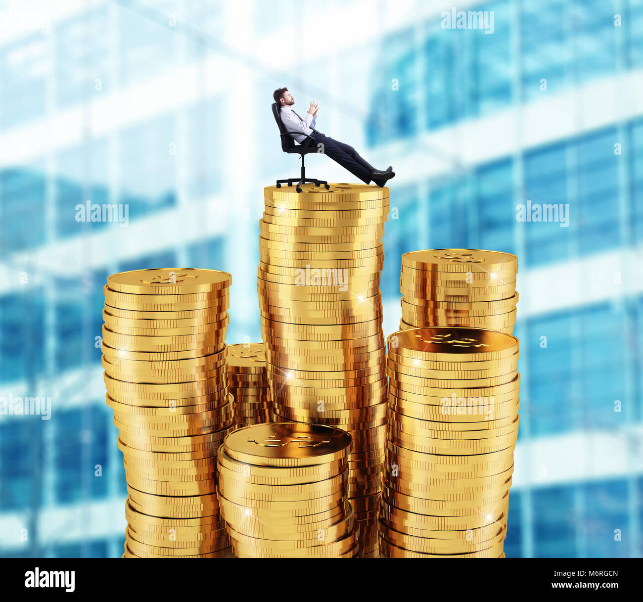 Successful businessman relaxing over piles of money. Concept of success and company growth - Stock Image