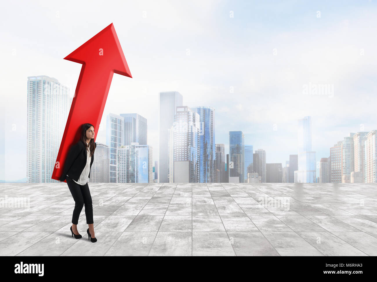 Businesswoman holds a big arrow. Concept of business growth and success - Stock Image