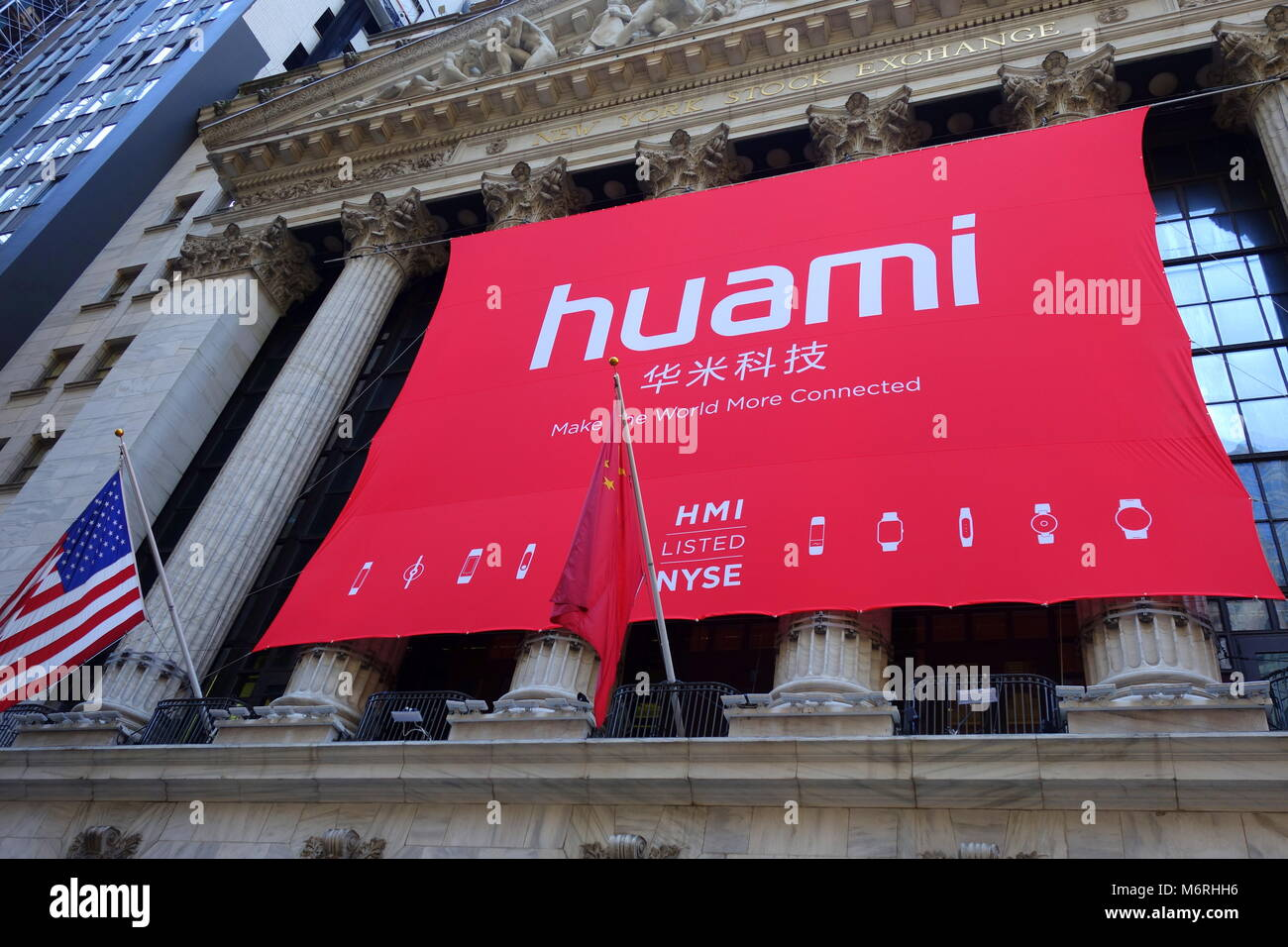 A large banner of Huami hanging on the exterior wall of the New York Stock Exchange (NYSE) on the day of their initial - Stock Image