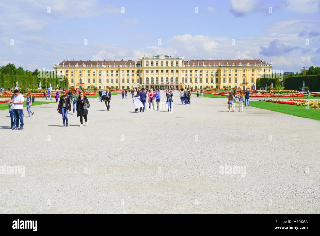 VIENNA,AUSTRIA - SEPTEMBER 4 2017; Tourists on space in front of Baroque architectural Schonbrunn Imperial Palace, - Stock Image