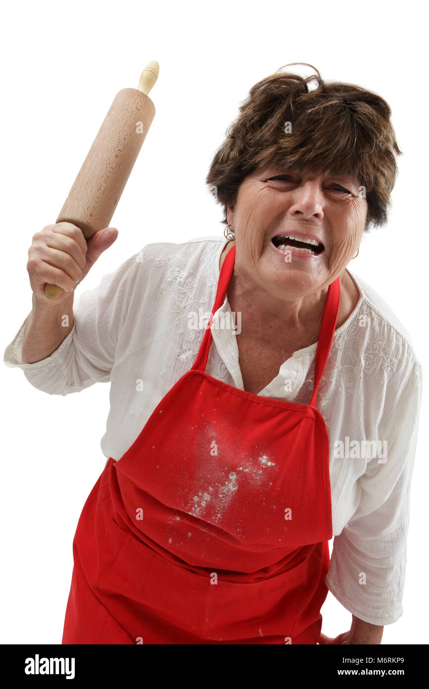 Photo of an old woman angry and threatening with a rolling pin. - Stock Image