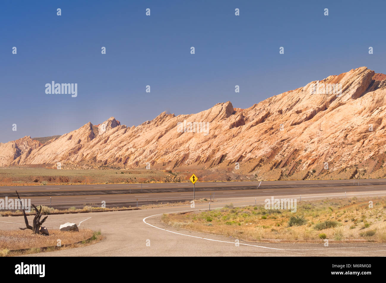 View of a highway in Utah; colorful rock formations in the background;  USA - Stock Image
