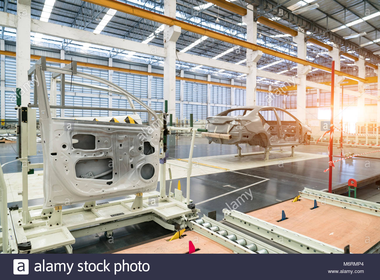 The simulated line door's parts (doors) prepared for installation at automotive plant. - Stock Image