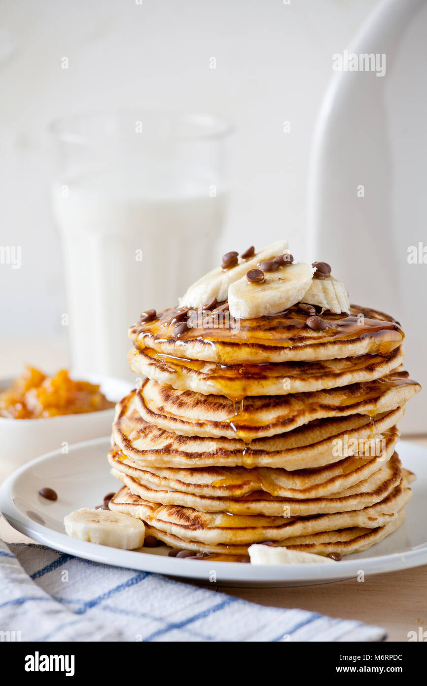 Stack of homemade pancakes with fresh fruits - Stock Image