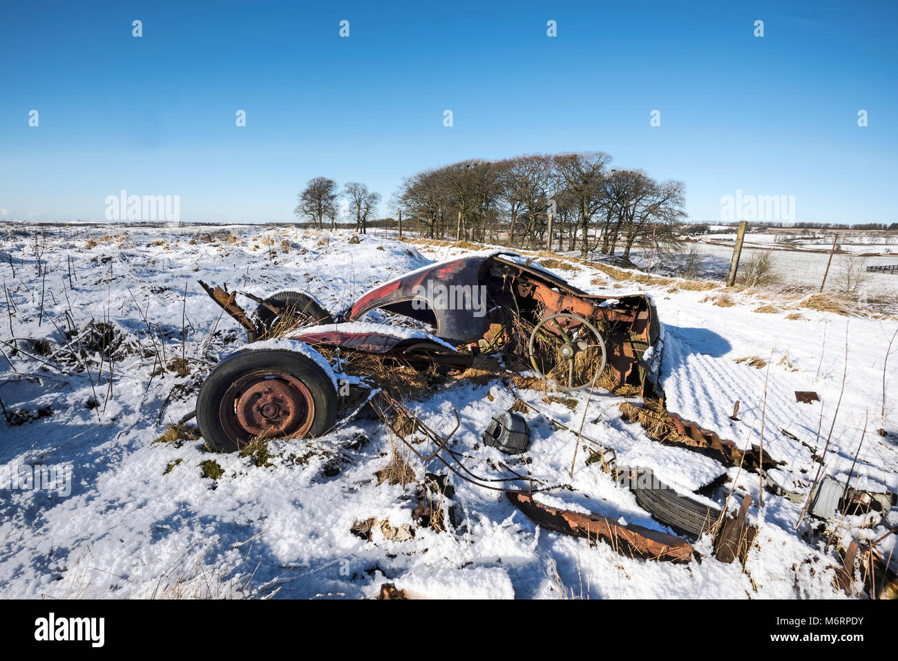 Abandoned car wreckage in rural central Scotland. - Stock Image