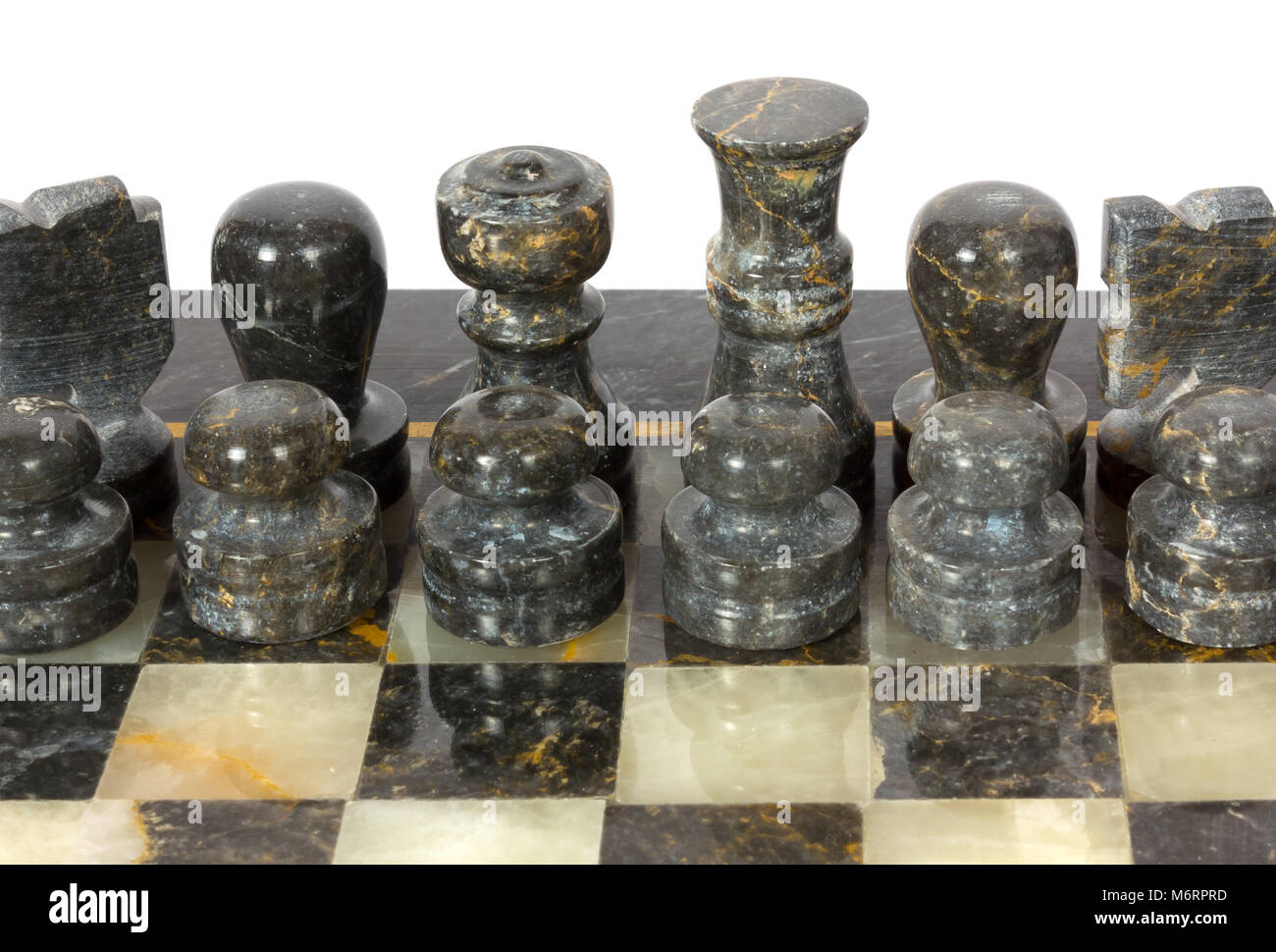 Black marble chessmen on a chessboard - Stock Image