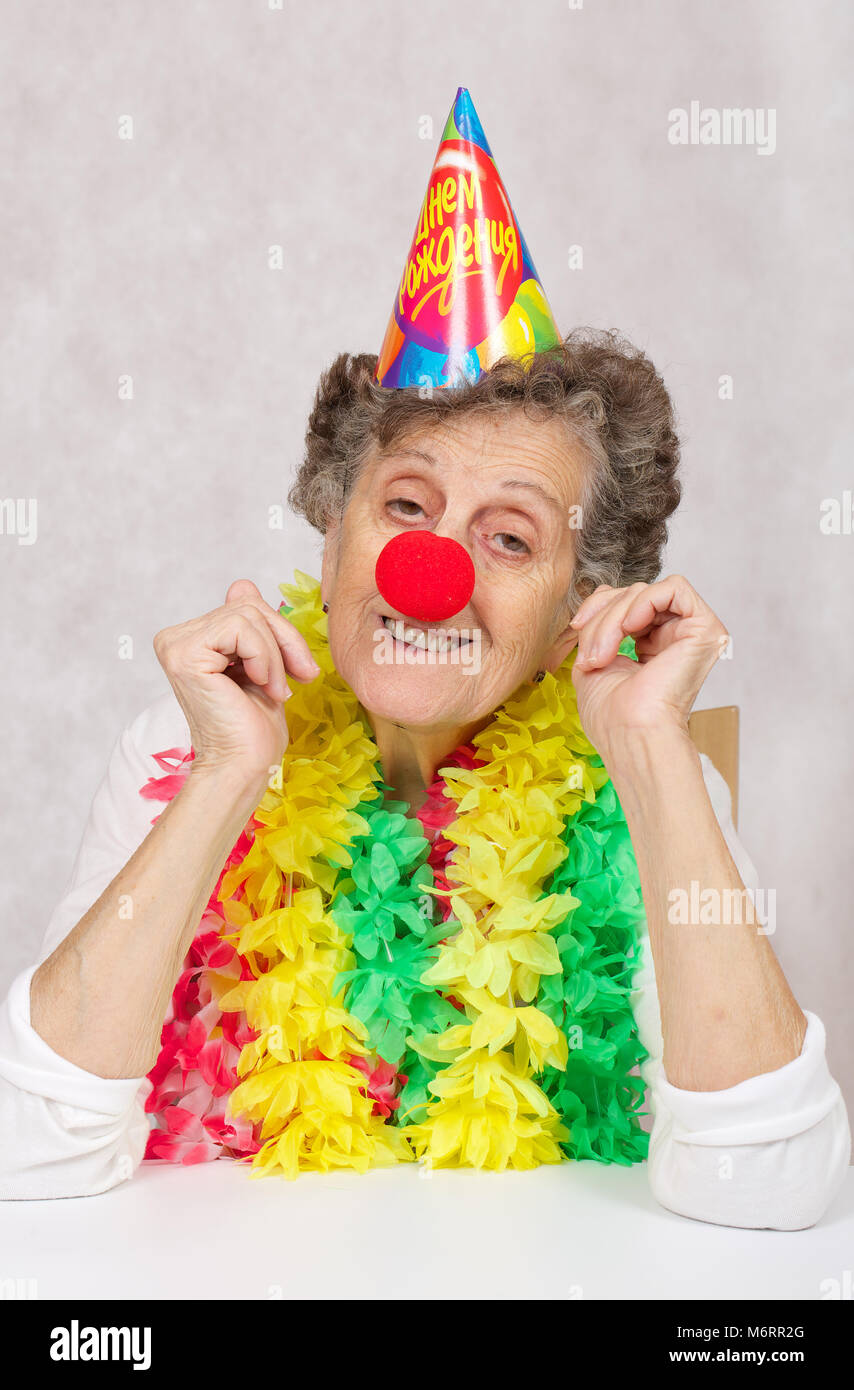 Senior Woman Of 80 Years Old Is Ready For Birthday PartyOn The Cone Translation From Russian Happy