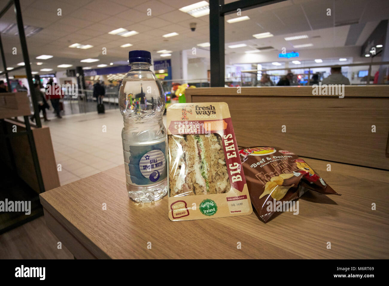 supermarket lunchtime cheap meal deal of sandwich drink and a snack in this photo water, triple sandwich and packet - Stock Image
