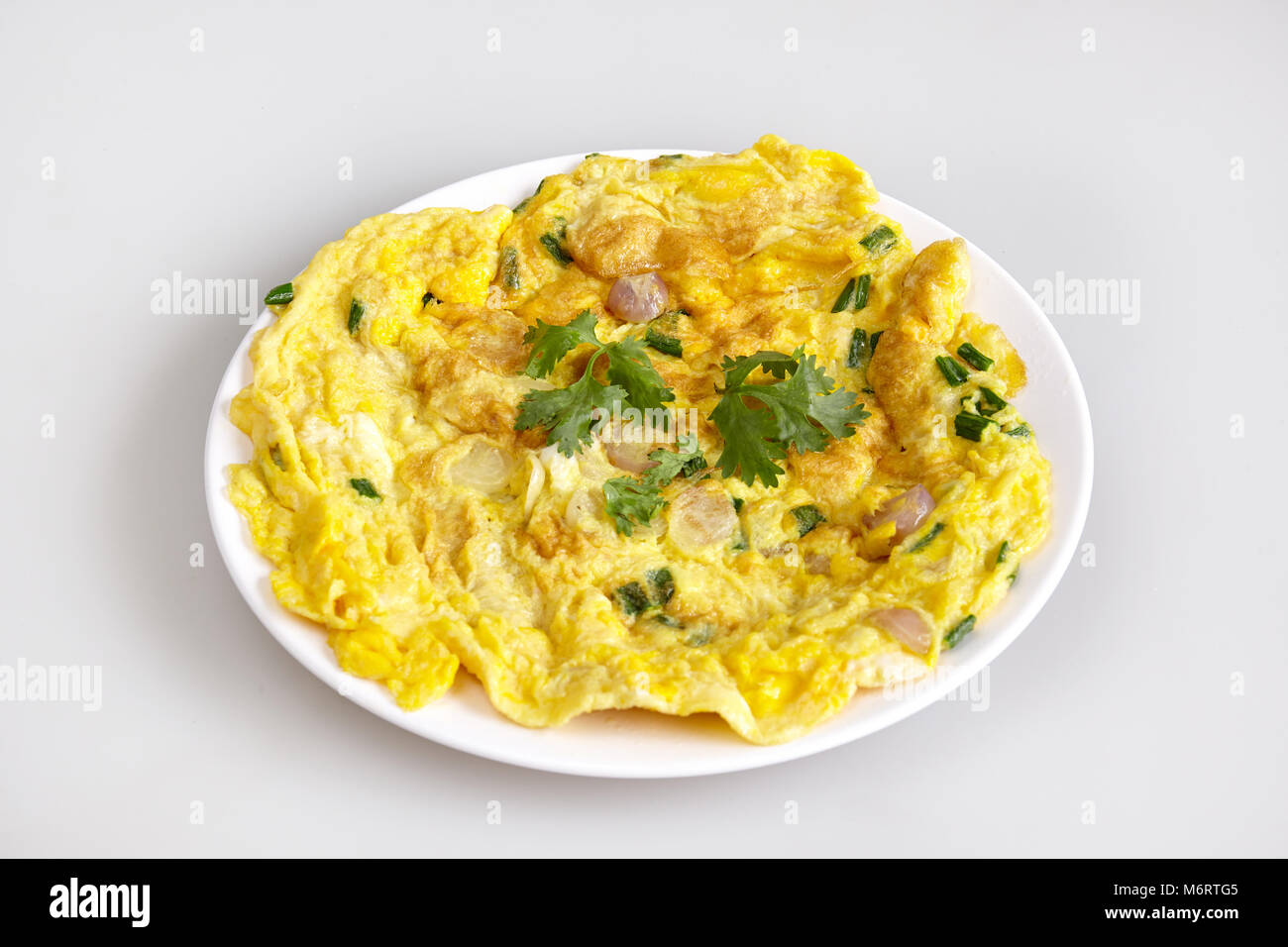 Omelet, Thai local food, with simple ingredient with herb parsley, healthy diet, white background - top view - Stock Image