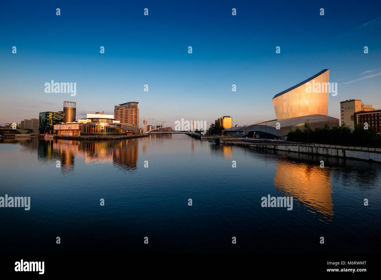 Lowry Centre at Salford Quays and Imperial War Museum on the Manchester ship canal - Stock Image