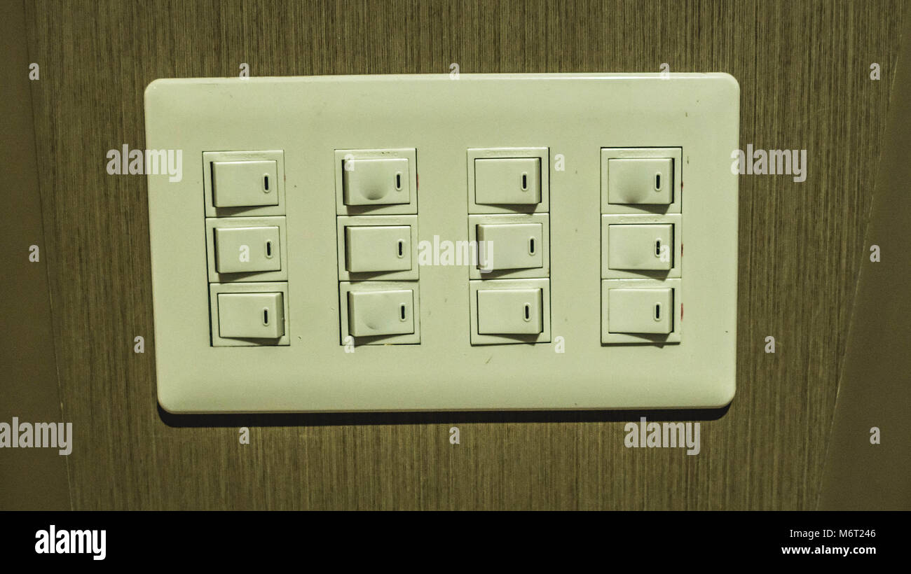 electrical control panel with multiple switches mounted on the wall ...