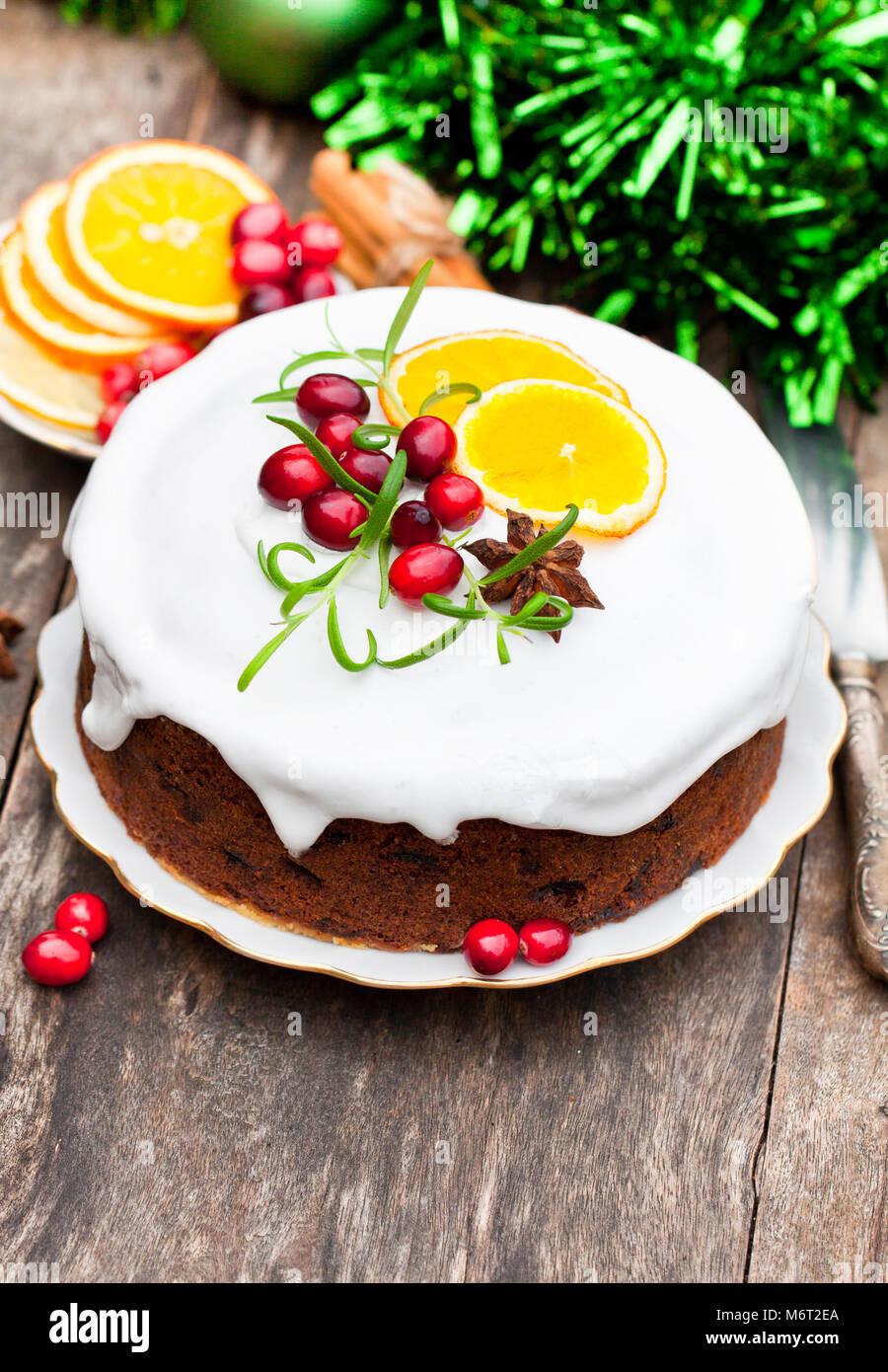 Christmas  Cake and Christmas Decorations. - Stock Image
