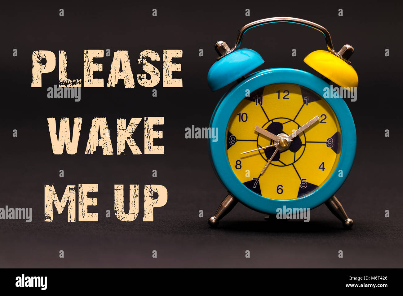 Concept,alarm clock with please wake me up phrase written on black