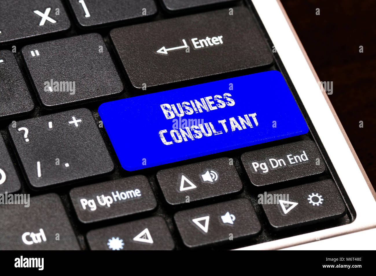 Business Concept - Blue Business Consultant Button on Slim. - Stock Image