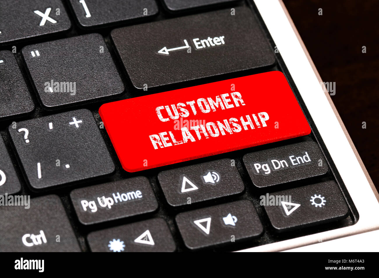 On the laptop keyboard the red button written CUSTOMER RELATIONSHIP. - Stock Image