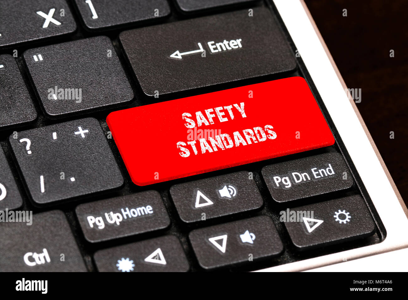 On the laptop keyboard the red button written Safety Standards. - Stock Image