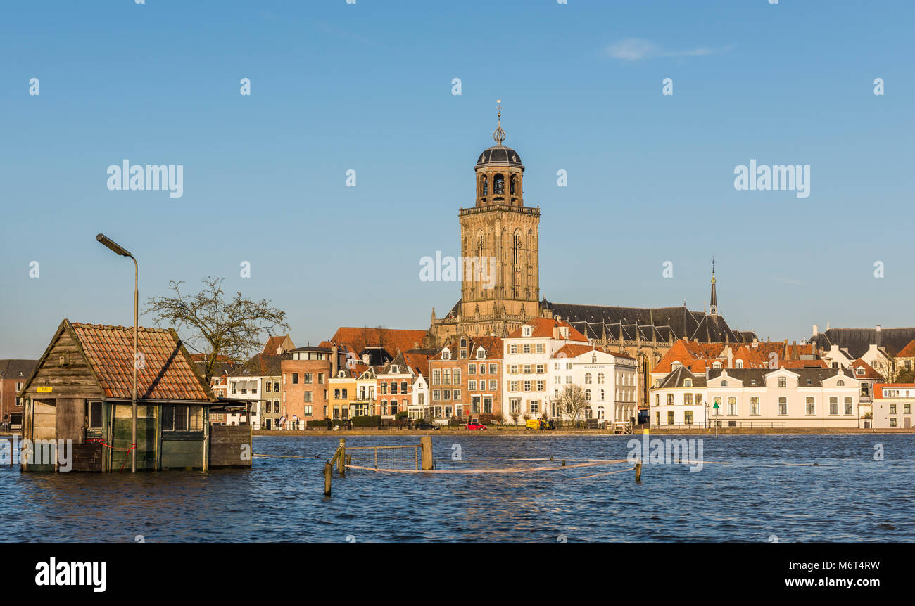 Deventer, The Netherlands - January 8, 2018: Flood in Deventer at the river IJssel in Gelderland with houses in Stock Photo