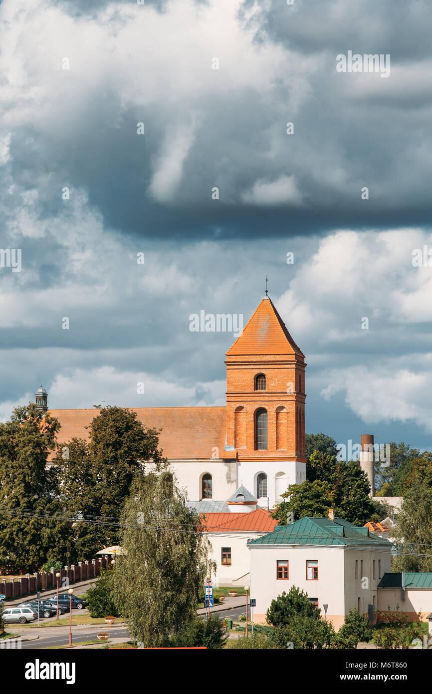 Mir, Belarus. Landscape Of Village Houses And Saint Nicolas Roman Catholic Church In Mir, Belarus. Famous Landmark. - Stock Image