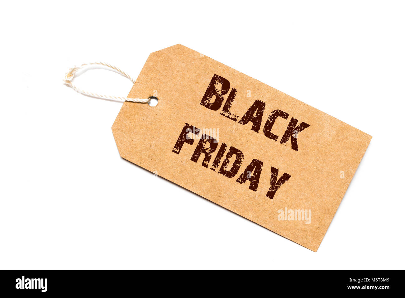 Black Friday sale sign - a paper price tag with a twine isolated on white. - Stock Image