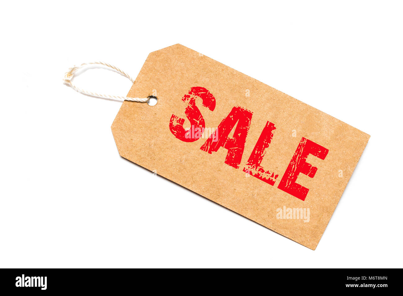 a brown paper label with the text sale written in it against a white   background - Stock Image