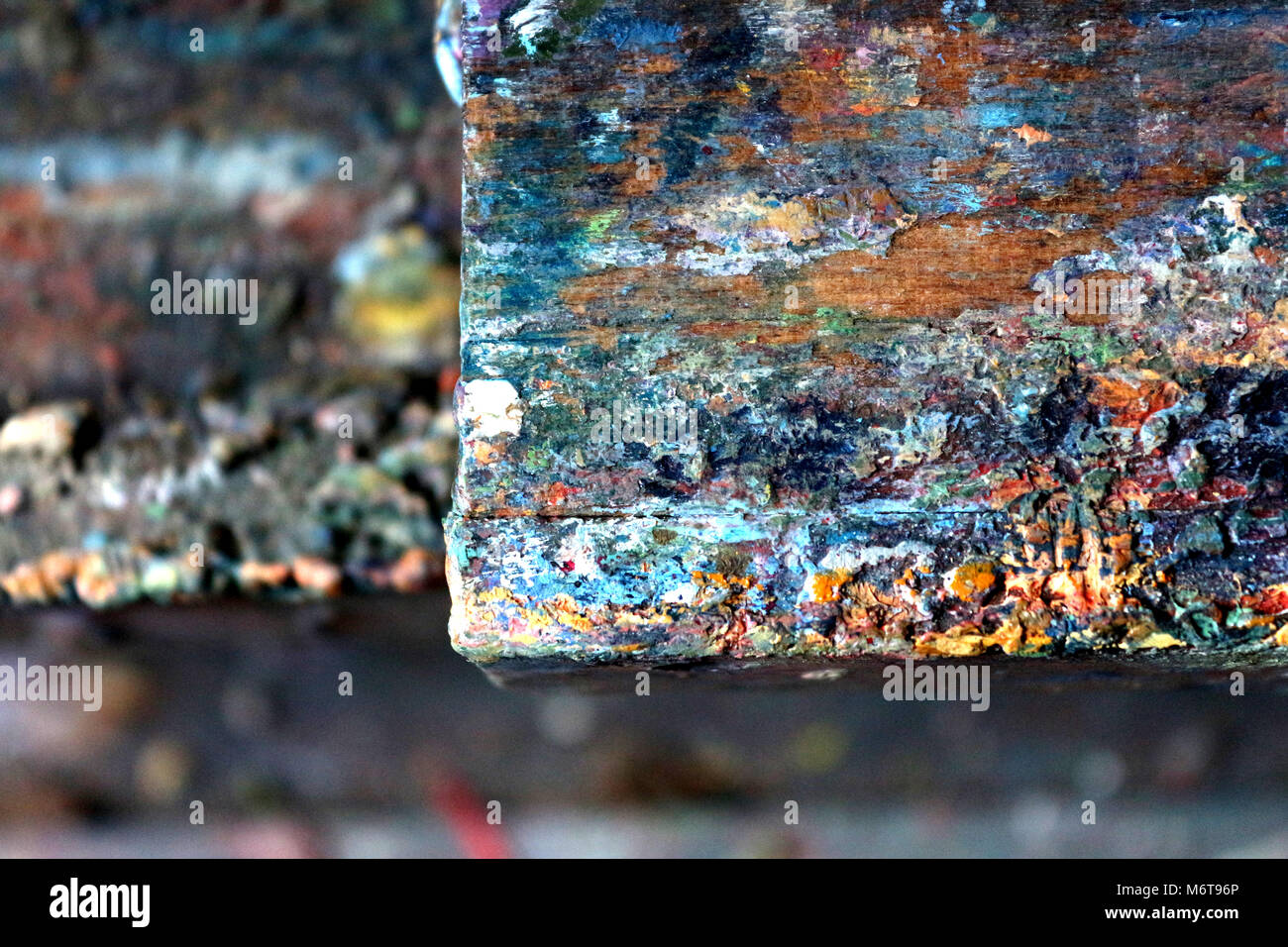 Paint spattered Artist's easel with the accumulation of decades Oil paint - Stock Image
