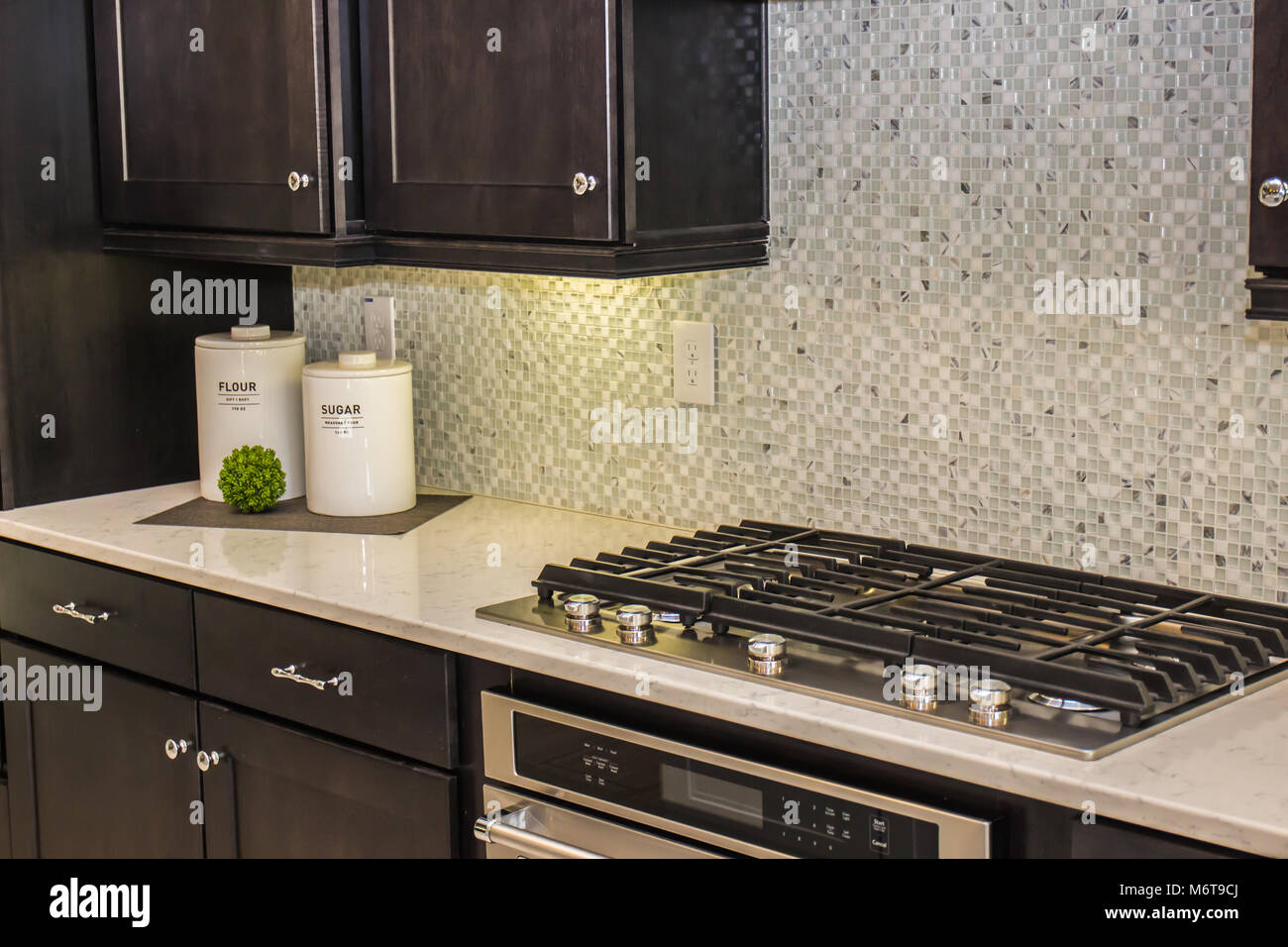 Modern Kitchen Counter With Canisters & Stove Top Stock ...
